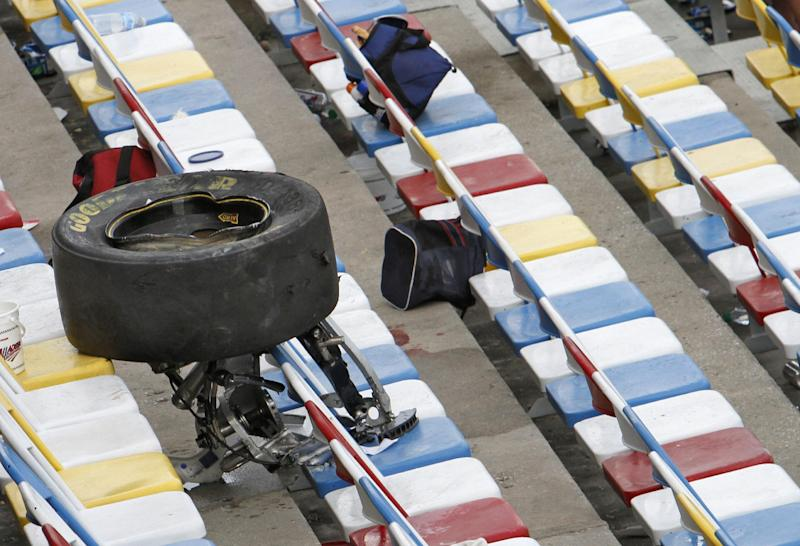 A wheel, tire and suspension parts sit in the stands after crash on the final lap of the NASCAR Nationwide Series auto race Saturday, Feb. 23, 2013, at Daytona International Speedway in Daytona Beach, Fla. Several fans were injured when large chunks of debris sailed into the grandstands after a car flew into the fence. (AP Photo/David Graham)
