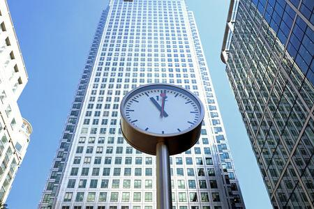 FILE PHOTO: A clock is seen in London's Financial centre at Canary Wharf In London, Britain, May 25, 2017. REUTERS/Russell Boyce/File Photo