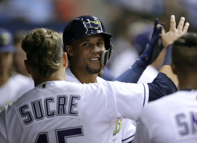 Carlos Gómez had every reason to smile after robbing a home run Tuesday. (AP Photo)