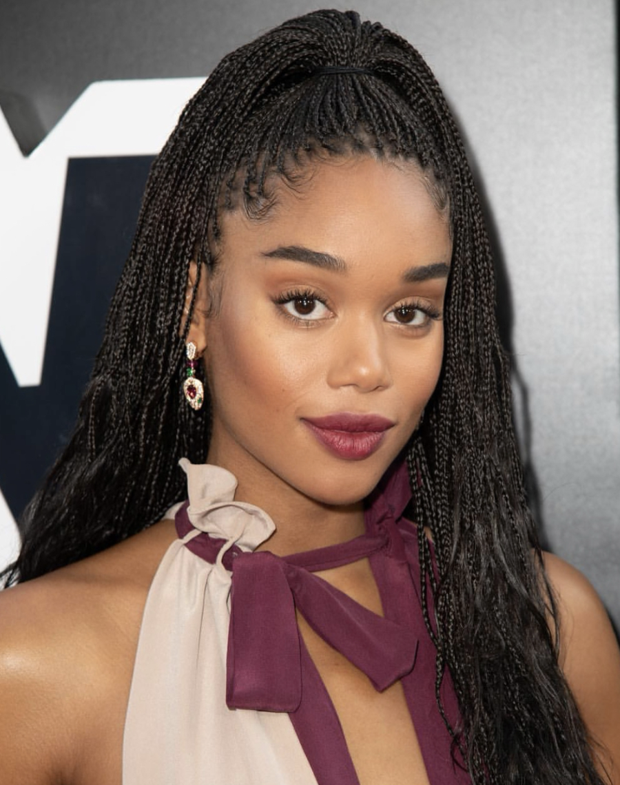 While our butts hurt just thinking about how long Laura Harrier had to sit in the salon chair in order to have these mini box braids installed, the end result is gorgeous. This particular style is the knotless version, which come without the traditional knot at the start of the braid. They're often more comfortable and put less tension on your scalp and edges.