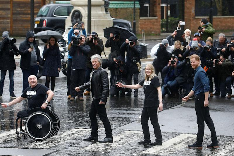 Britain's Prince Harry, Jon Bon Jovi and two choir members walk on the famous zebra crossing that The Beatles walked across, during a visit at Abbey Road Studios in London, Britain February 28, 2020. REUTERS/Henry Nicholls