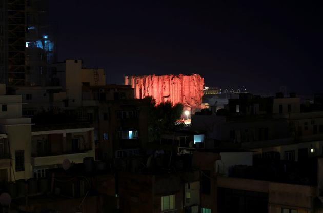 Lebanon marks one year anniversary of Beirut port explosion by lighting up a damaged building. (Photo: EMILIE MADI via REUTERS)
