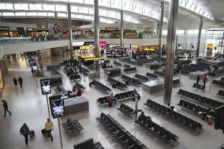 Passengers sit in the departure lounge in Terminal 2 at Heathrow Airport in London