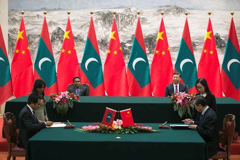 Maldives President Abdulla Yameen and China's President Xi Jinping attend a signing meeting at the Great Hall of the People in Beijing, China