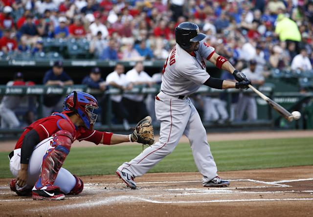 Boston Red Sox' Shane Victorino, right, connects for a single in front of Texas Rangers catcher Robinson Chirinos during the first inning of a baseball game on Saturday, May 10, 2014, in Arlington, Texas. (AP Photo/Jim Cowsert)