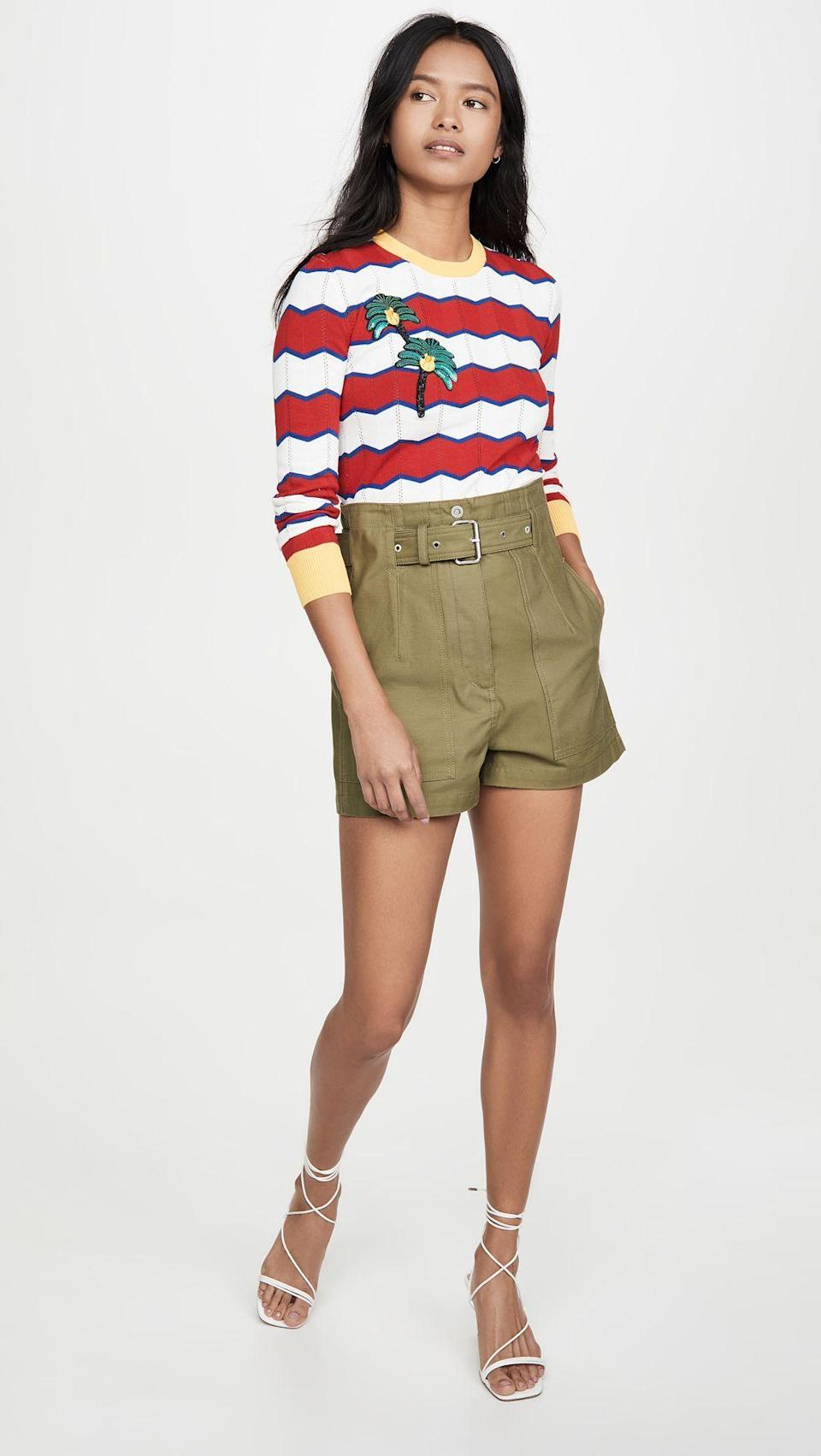 """<p><strong>Stella Jean</strong></p><p>shopbop.com</p><p><strong>$192.00</strong></p><p><a href=""""https://go.redirectingat.com?id=74968X1596630&url=https%3A%2F%2Fwww.shopbop.com%2Fstriped-sweater-stella-jean%2Fvp%2Fv%3D1%2F1549211054.htm&sref=https%3A%2F%2Fwww.cosmopolitan.com%2Fstyle-beauty%2Ffashion%2Fg32950282%2Fcute-rainy-day-outfit-ideas%2F"""" rel=""""nofollow noopener"""" target=""""_blank"""" data-ylk=""""slk:Shop Now"""" class=""""link rapid-noclick-resp"""">Shop Now</a></p><p>A thin knit sweater with bold stripes adds a pop of color to some army-green high-waisted shorts. Opt for knee-high rain boots and a raincoat if it's really pouring outside. </p>"""