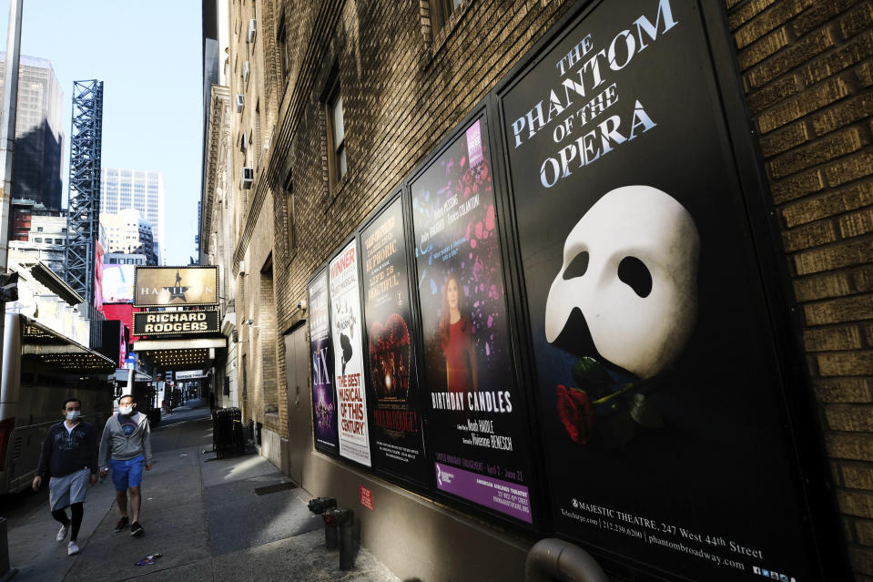 FILE - Broadway posters appear outside the Richard Rodgers Theatre during Covid-19 lockdown in New York on May 13, 2020. The entertainment world has trudged on, by streaming, zooming and improvising. But its in-person soul was nearly snuffed out, and with it a lifeblood of human connection. (Photo by Evan Agostini/Invision/AP, File)