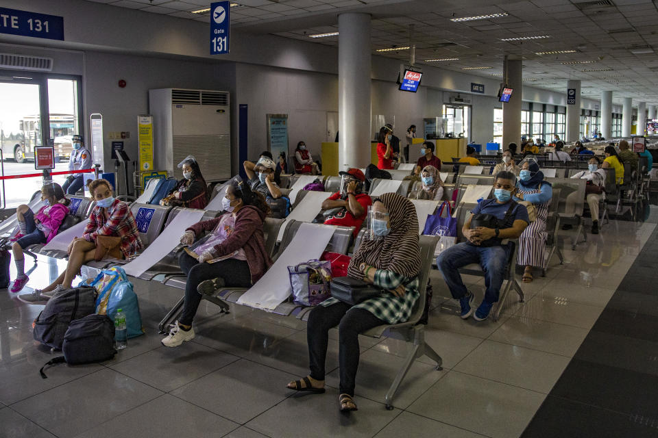 FILE PHOTO: Travelers wearing face masks and face shields to protect against COVID-19 walk inside Ninoy Aquino International Airport on September 30, 2020 in Manila, Philippines. (Photo by Ezra Acayan/Getty Images)