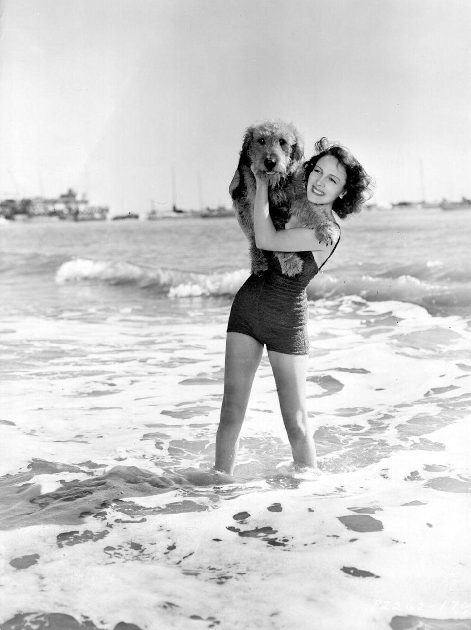 "<p>Actress Louise Campbell on the beach in Chicago, Illinois. </p><p>Other celebrity visitors this year:<span class=""redactor-invisible-space""> Actress Gloria Swanson, philanthropist Myrtle Sengstacke.<br></span></p>"