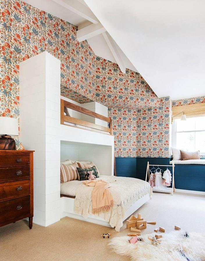 <p>Give your kids the ultimate sleepover spot that's outfitted with statement wallpaper, well-designed bunk beds, and enough floor space to play games before the lights go out.</p>