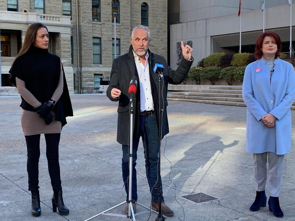 Virginia Stone, left, Zane Novak, centre, and Jan Damery, right, made an appeal for Calgarians to consider mayoral candidates beyond the council incumbents ahead of Monday's municipal election. (Mike Symington/CBC - image credit)