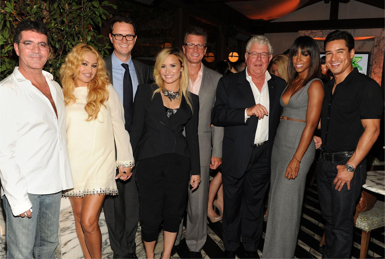 "SImon Cowell, Paulina Rubio, Peter Rice, Chairman and CEO, Fox Networks Group, Demi Lovato, Kevin Reilly, Chairman, Entertainment Fox Broadcasting, David Hill, Senior Executive Vice President, 21st Century Fox, Kelly Rowland, and Mario Lopez attend Fox's ""The X Factor"" Season 3 premiere party at Ciccone Restaurant on September 5, 2013 in West Hollywood, California."