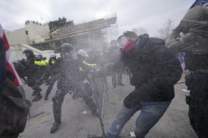 FILE - In this Jan. 6, 2021, file photo, supporters of then-President Donald Trump try to break through a police barrier at the Capitol in Washington. (AP Photo/Julio Cortez, File)