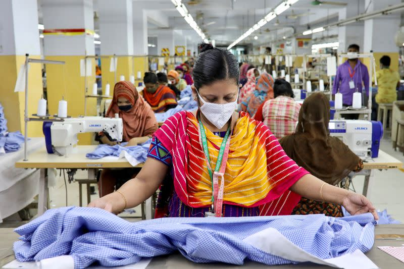 FILE PHOTO: A woman works in a garment factory, as factories reopened after the government has eased the restrictions amid concerns over coronavirus disease (COVID-19) outbreak in Dhaka