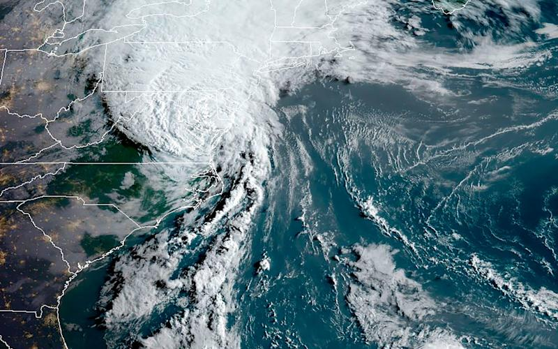 A satellite image shows Isaias off the US east coast in the Atlantic Ocean - RAMMB/NOAA/NESDIS/AFP