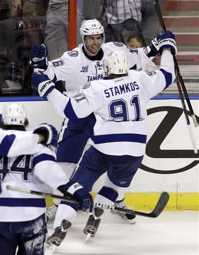 Tampa Bay Lightning's Teddy Purcell (16) is congratulated by teammate Steven Stamkos (91) after Purcell scored the game tying goal against the Florida Panthers in the third period of an NHL hockey game in Sunrise, Fla., Saturday, Feb. 16, 2013. The Tampa Bay Lightning won 6-5 in overtime. (AP Photo/Alan Diaz)
