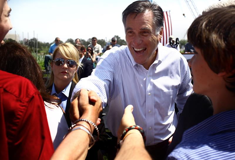 Republican presidential candidate, former Massachusetts Gov. Mitt Romney, greets supporters during a campaign stop in Portsmouth, Va., on Thursday, May 3, 2012. (AP Photo/Virginian-Pilot,Ross Taylor)