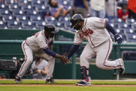 Atlanta Braves' Pablo Sandoval, right, celebrates his two-run home run with third base coach Ron Washington during the seventh inning of the second baseball game of a doubleheader against the Washington Nationals at Nationals Park, Wednesday, April 7, 2021, in Washington. The Braves won the second game 2-0. (AP Photo/Alex Brandon)