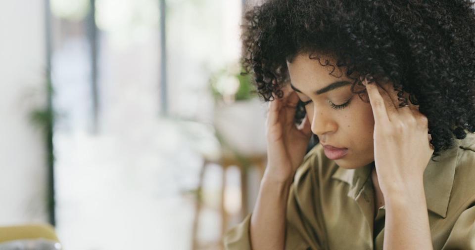 Closeup shot of a young woman looking stressed out