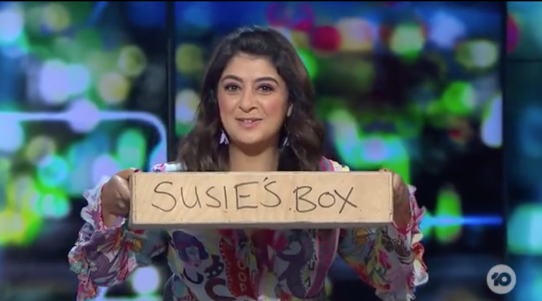 Susie Youssef displays the 'empty box' she keeps under her desk as a footrest
