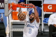 Los Angeles Lakers' Anthony Davis dunks against the Dallas Mavericks during the first half of an NBA basketball game Friday, Dec. 25, 2020, in Los Angeles. (AP Photo/Ringo H.W. Chiu)