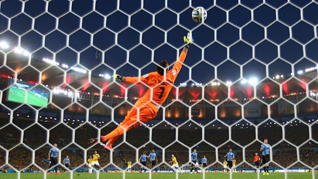 Fernando Muslera James Rodriguez Colombia Uruguay FIFA World Cup Brazil 2014