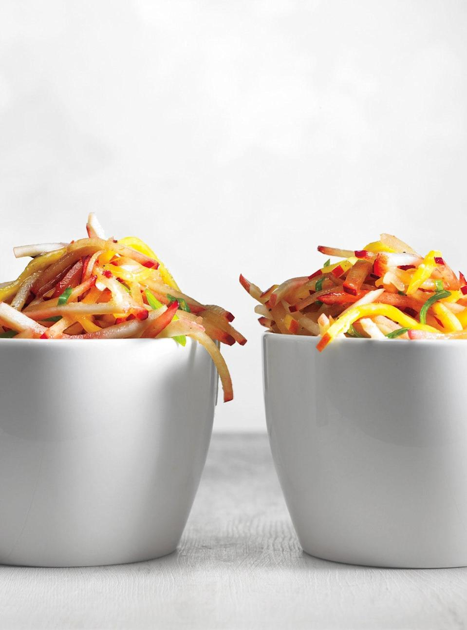 """Serve this succulent slaw as a side or condiment for grilled chicken or pork. Use slightly underripe fruits, which julienne better than soft, juicy ones. <a href=""""https://www.epicurious.com/recipes/food/views/stone-fruit-slaw-366407?mbid=synd_yahoo_rss"""" rel=""""nofollow noopener"""" target=""""_blank"""" data-ylk=""""slk:See recipe."""" class=""""link rapid-noclick-resp"""">See recipe.</a>"""
