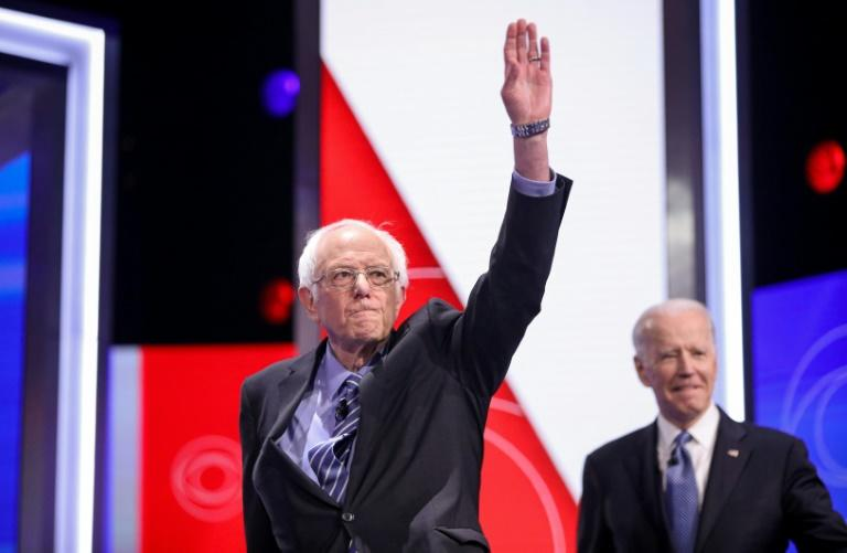 Despite a string of losses to Joe Biden (R), Bernie Sanders (L) says he's staying in the nomination race