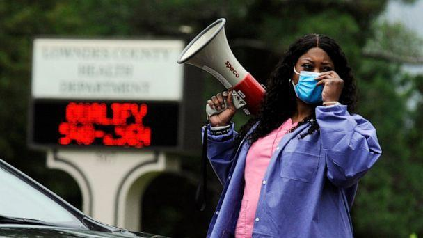 PHOTO: Health care worker Tonya Wilkes adjusts her mask while working at a Lowndes County coronavirus testing site in Hayneville, Ala., May 27, 2020. (Jay Reeves/AP)