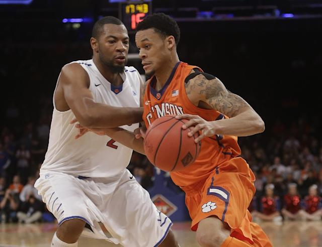 SMU's Shawn Williams (2) defends Clemson's K.J. McDaniels (32) during the second half of an NCAA college basketball game in the semifinals of the NIT Tuesday, April 1, 2014, in New York. SMU won the game 65-59. (AP Photo/Frank Franklin II)