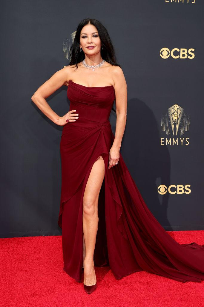 Catherine Zeta-Jones wearing a maroon strapless gown at the 73rd Primetime Emmy Awards on September 19, 2021
