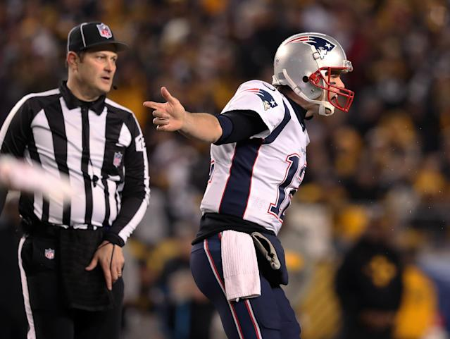 Tom Brady and the Patriots are still in the hunt for a first-round bye in the AFC playoffs. (Getty Images)