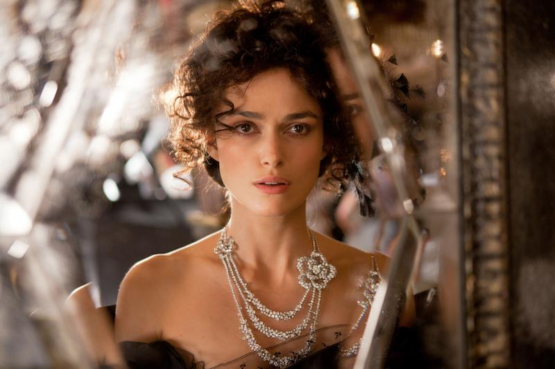 """FILE - This publicity film image released by Focus Features shows Keira Knightley in a scene from """"Anna Karenina."""" While """"Pride & Prejudice"""" and """"Atonement"""" were fresh, lively takes for an age that finds costume drama stuffy, director Joe Wright planned a wild and possibly off-putting ride on """"Anna Karenina,"""" confining most of the action to a dilapidated theater where the actors would perform in a stylized cinematic ballet without the usual grand sweep of period-drama locations. (AP Photo/Focus Features, Laurie Sparham, File)"""