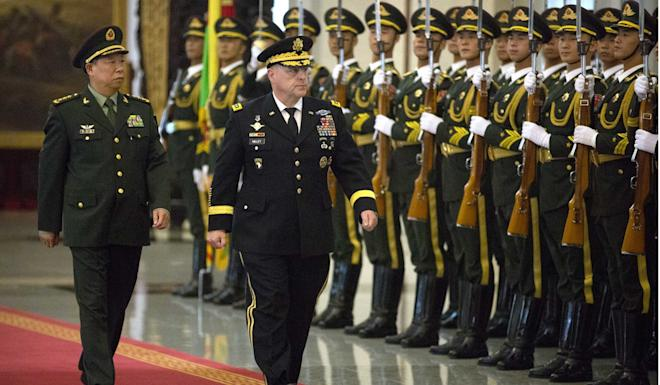 General Mark Milley reviews an honour guard during his visit to Beijing in 2016. Photo: AFP