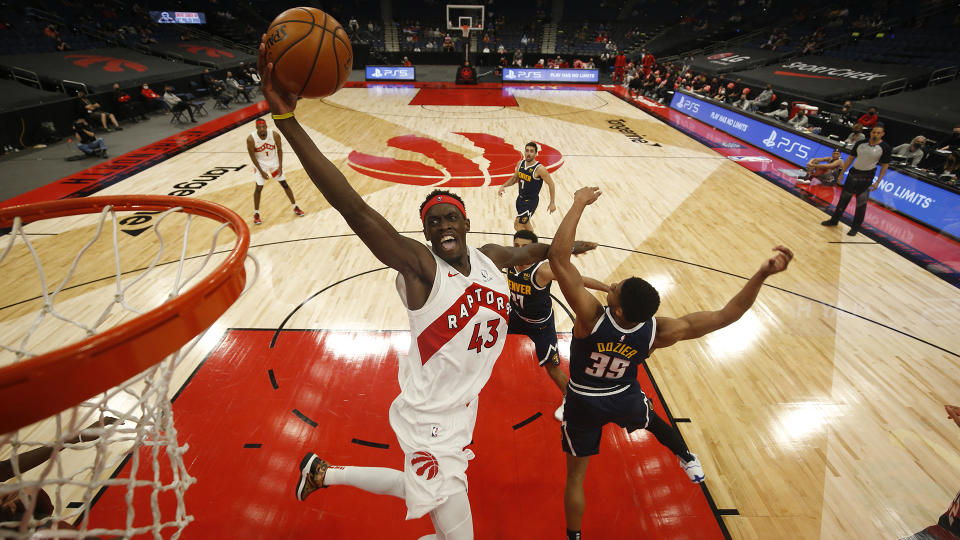 TAMPA, FL- MARCH 24: Pascal Siakam #43 of the Toronto Raptors drives to the basket during the game against the Denver Nuggets on March 24, 2021 at Amalie Arena in Tampa, Florida. NOTE TO USER: User expressly acknowledges and agrees that, by downloading and or using this Photograph, user is consenting to the terms and conditions of the Getty Images License Agreement. Mandatory Copyright Notice: Copyright 2021 NBAE (Photo by Scott Audette/NBAE via Getty Images)