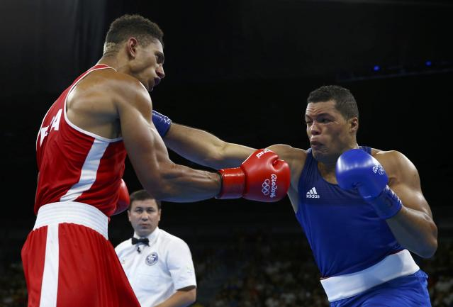 2016 Rio Olympics - Boxing - Final - Men's Super Heavy (+91kg) Final Bout 273 - Riocentro - Pavilion 6 - Rio de Janeiro, Brazil - 21/08/2016. Tony Yoka (FRA) of France and Joseph Joyce (GBR) of Britain compete. REUTERS/Peter CziborraFOR EDITORIAL USE ONLY. NOT FOR SALE FOR MARKETING OR ADVERTISING CAMPAIGNS.
