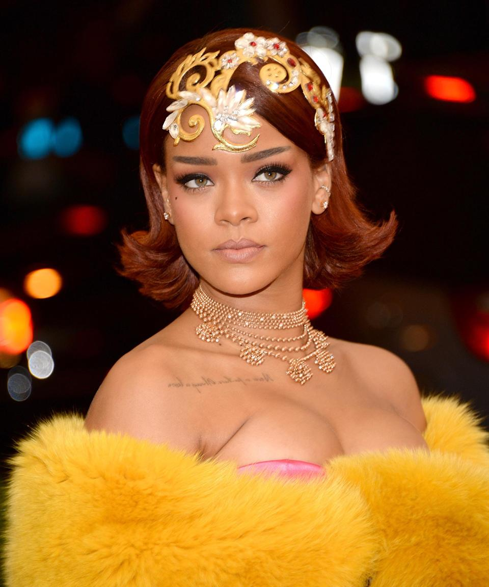 """<strong><h2>Rihanna</h2></strong>We know, we know: Rihanna is brunette. Still, she's played with ruby-red hair more than once — think the <em>Loud</em> era and the 2015 Met Gala.<span class=""""copyright"""">Photo: Kevin Mazur/WireImage.</span>"""