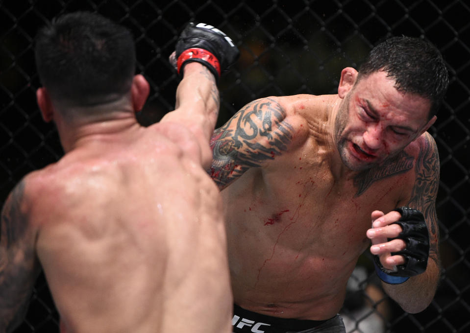 (L-R) Pedro Munhoz punches Frankie Edgar in their bantamweight fight during UFC Fight Night at UFC Apex on Aug. 22, 2020 in Las Vegas. (Photo by Chris Unger/Zuffa LLC)