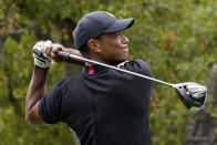 Tiger Woods hits from the 11th tee during the first round of the Zozo Championship golf tournament Thursday, Oct. 22, 2020, in Thousand Oaks, Calif. (AP Photo/Marcio Jose Sanchez)