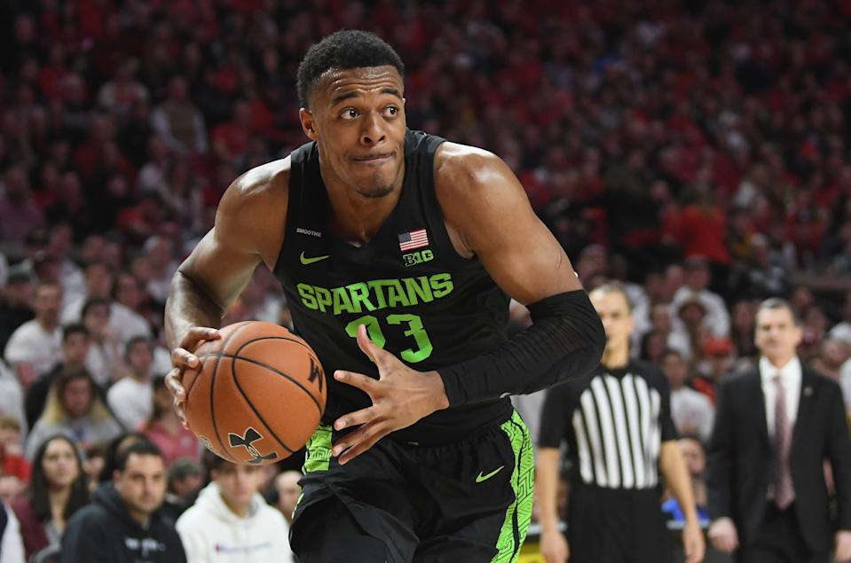 Xavier Tillman Sr. #23 of the Michigan State Spartans handles the ball against the Maryland Terrapins at Xfinity Center on February 29, 2020 in College Park, Maryland.