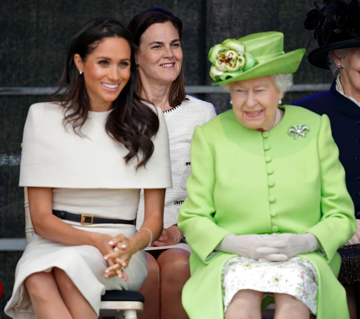 WIDNES, UNITED KINGDOM - JUNE 14: (EMBARGOED FOR PUBLICATION IN UK NEWSPAPERS UNTIL 24 HOURS AFTER CREATE DATE AND TIME) Meghan, Duchess of Sussex and Queen Elizabeth II (accompanied by Samantha Cohen) attend a ceremony to open the new Mersey Gateway Bridge on June 14, 2018 in Widnes, England. Meghan Markle married Prince Harry last month to become The Duchess of Sussex and this is her first engagement with the Queen. During the visit the pair will open a road bridge in Widnes and visit The Storyhouse and Town Hall in Chester. (Photo by Max Mumby/Indigo/Getty Images)