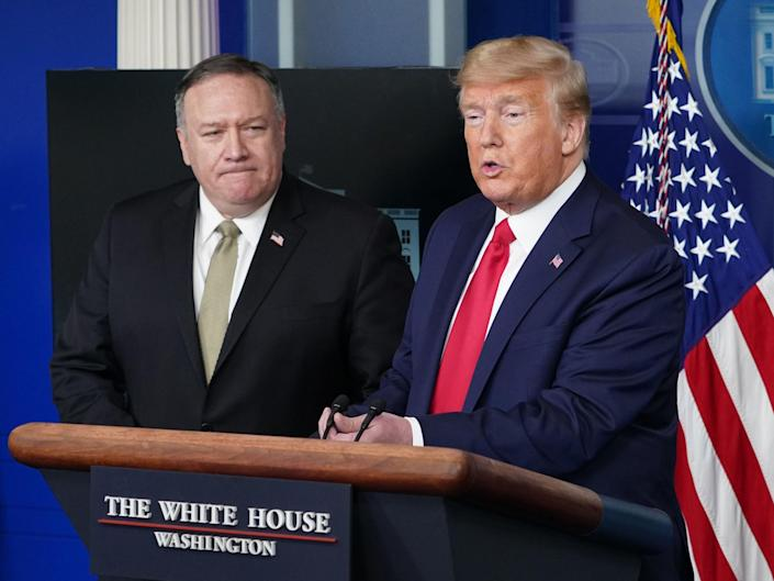 US Secretary of States Mike Pompeo watches US President Donald Trump speak during the daily briefing on the novel coronavirus, in the Brady Briefing Room at the White House on 8 April 2020, in Washington, DC ((AFP via Getty Images))
