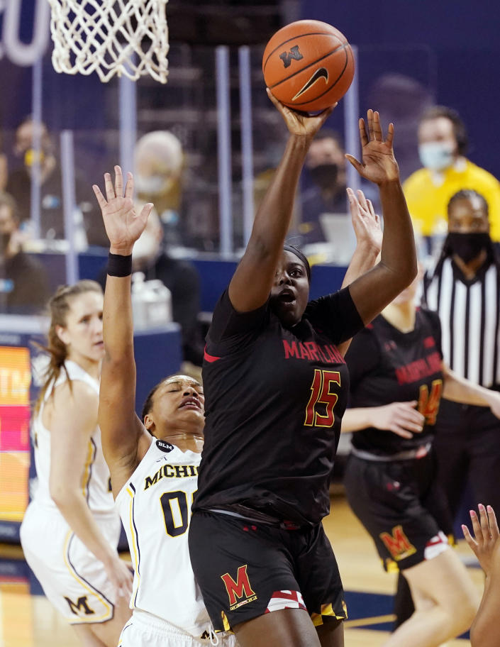 Maryland guard Ashley Owusu (15) takes a shot as Michigan forward Naz Hillmon (00) defends during the second half of an NCAA college basketball game, Thursday, March 4, 2021, in Ann Arbor, Mich. (AP Photo/Carlos Osorio)
