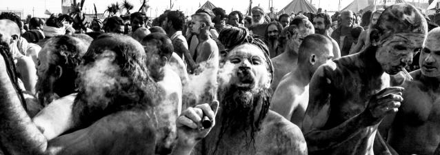 ALLAHABAD, INDIA - FEBRUARY 10: (EDITORS NOTE: Image was created using the iPhone panoramic application) Naga Sadhus, naked Hindu holy men, smoke marijuana as they walk in procession after having bathed on the banks of Sangam, the confluence of the holy rivers Ganges, Yamuna and the mythical Saraswati, on the auspicious bathing day of Mauni Amavasya during the Maha Kumbh Mela on February 10, 2013 in Allahabad, India. The Maha Kumbh Mela, believed to be the largest religious gathering on earth is held every 12 years on the banks of Sangam, the confluence of the holy rivers Ganga, Yamuna and the mythical Saraswati. The Kumbh Mela alternates between the cities of Nasik, Allahabad, Ujjain and Haridwar every three years. The Maha Kumbh Mela celebrated at the holy site of Sangam in Allahabad, is the largest and holiest, celebrated over 55 days, it is expected to attract over 100 million people who will bathe in holy waters to wash away their sins. (Photo by Daniel Berehulak/Getty Images)