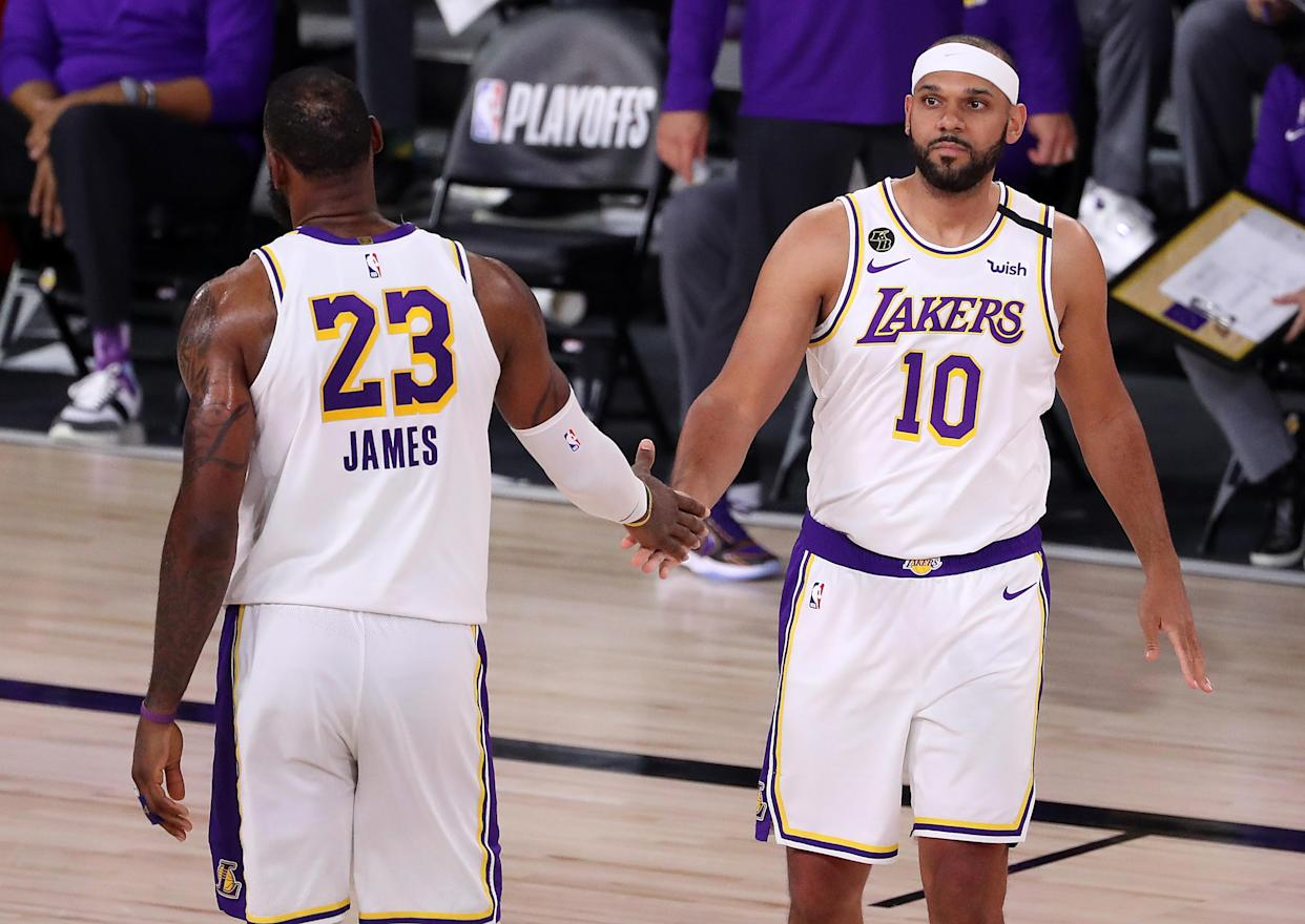LeBron James #23 of the Los Angeles Lakers high fives Jared Dudley #10 of the Los Angeles Lakers during the fourth quarter in Game Five of the Western Conference Second Round during the 2020 NBA Playoffs at AdventHealth Arena at the ESPN Wide World Of Sports Complex on September 12, 2020 in Lake Buena Vista, Florida. NOTE TO USER: User expressly acknowledges and agrees that, by downloading and or using this photograph, User is consenting to the terms and conditions of the Getty Images License Agreement. (Photo by Michael Reaves/Getty Images)