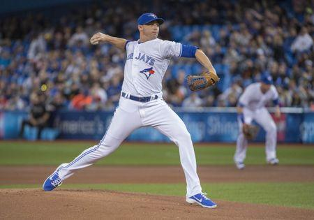 Apr 14, 2017; Toronto, Ontario, CAN; Toronto Blue Jays starting pitcher Aaron Sanchez (41) throws a pitch during the first inning against the Baltimore Orioles at Rogers Centre. Mandatory Credit: Nick Turchiaro-USA TODAY Sports