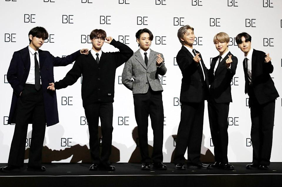 <p>BTS smiles for the cameras during a press conference ahead of the release of their album <em>Be</em> on Friday in Seoul, South Korea.</p>
