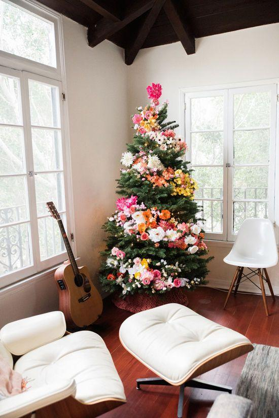 """<p>If you're already over the cold, snowy days, this colorful flower bomb of a tree will warm your heart all winter longer.</p><p><a class=""""link rapid-noclick-resp"""" href=""""https://www.amazon.com/Juvale-Artificial-Flower-Heads-Decorations/dp/B07BMQ5393/?tag=syn-yahoo-20&ascsubtag=%5Bartid%7C10055.g.2707%5Bsrc%7Cyahoo-us"""" rel=""""nofollow noopener"""" target=""""_blank"""" data-ylk=""""slk:SHOP FAKE FLOWERS"""">SHOP FAKE FLOWERS</a> </p><p><em><a href=""""http://www.designlovefest.com/2015/12/diy-floral-tree/"""" rel=""""nofollow noopener"""" target=""""_blank"""" data-ylk=""""slk:Get the tutorial at Design Love Fest »"""" class=""""link rapid-noclick-resp"""">Get the tutorial at Design Love Fest »</a></em><br></p>"""