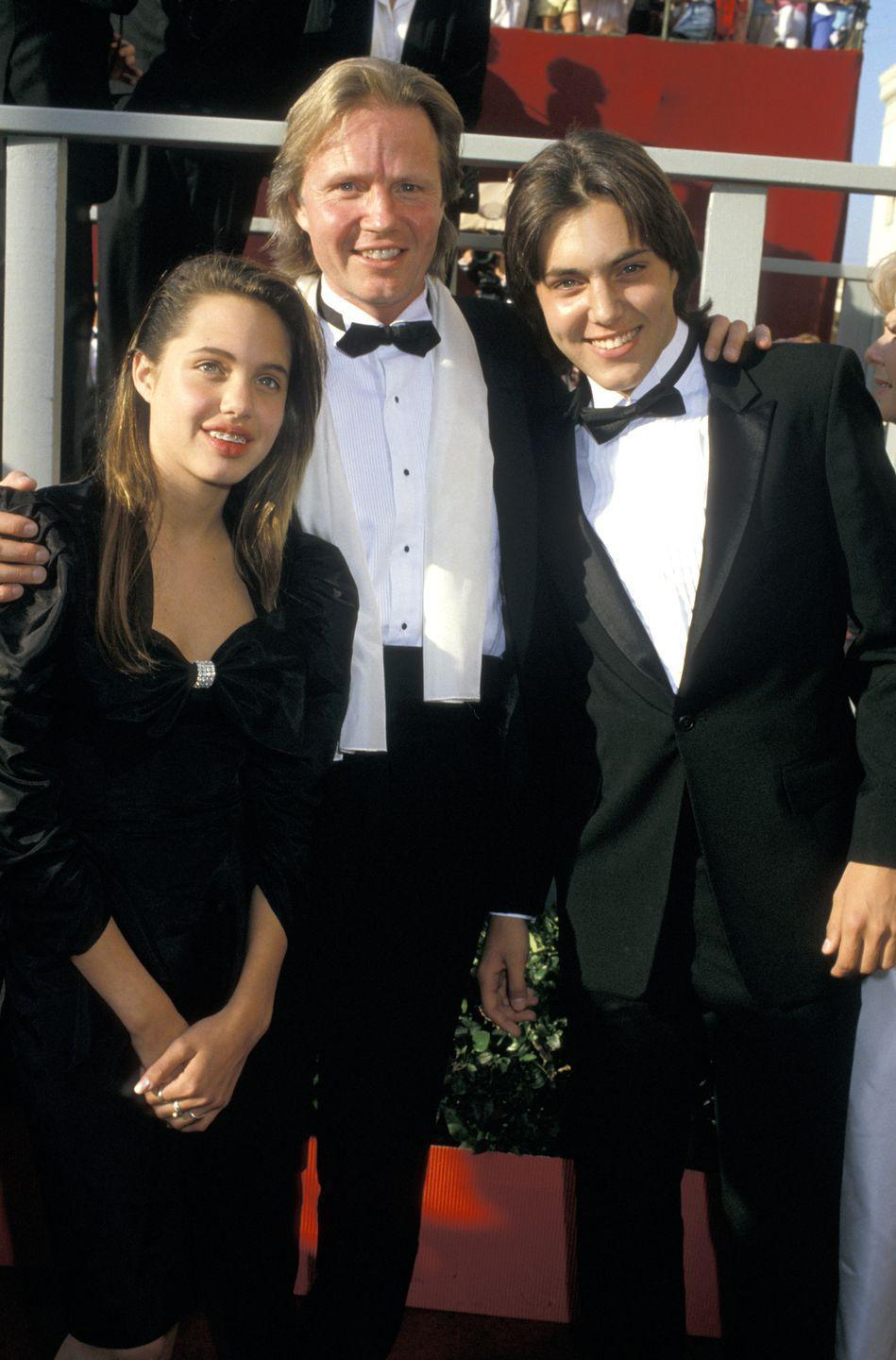 <p>Angelina Jolie is another celeb who grew up in the limelight. Having attended some red carpet events as a teen, Angelina was spotted with her father Jon Voight and a mouthful of braces.</p>