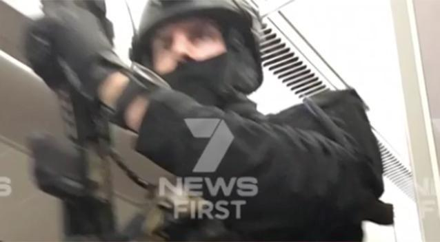 Officials boarded the plane and told everyone to remain in their seats. Photo: 7 News